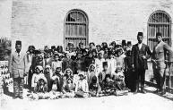 Abul Khasib March 1917 [Group of Arab children - possibly a school class, and three men]